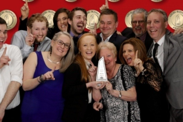 The CAVH team celebrating with the award